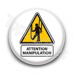 Badge panneau attention manipulation
